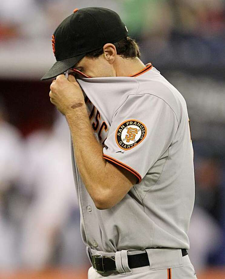 San Francisco Giants pitcher Barry Zito walks to the Giants' dugout following the eighth inning of interleague  baseball action against the Toronto Blue Jays in Toronto Friday, June 18, 2010. Photo: Darren Calabrese, AP