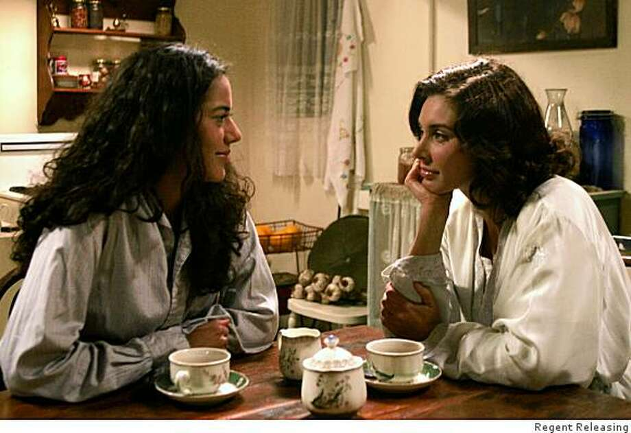 Lisa Ray as Miriam and Sheetal Sheth as Amina in THE WORLD UNSEEN. Photo: Regent Releasing
