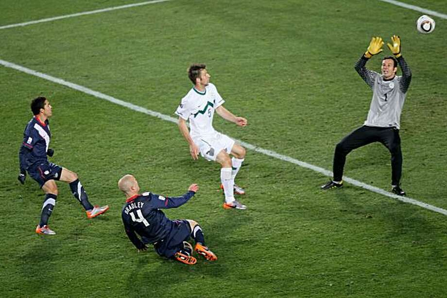 JOHANNESBURG, SOUTH AFRICA - JUNE 18:  Michael Bradley of the United States scores his side's second goal past Samir Handanovic of Slovenia during the 2010 FIFA World Cup South Africa Group C match between Slovenia and USA at Ellis Park Stadium on June 18, 2010 in Johannesburg, South Africa. Photo: Christof Koepsel, Getty Images
