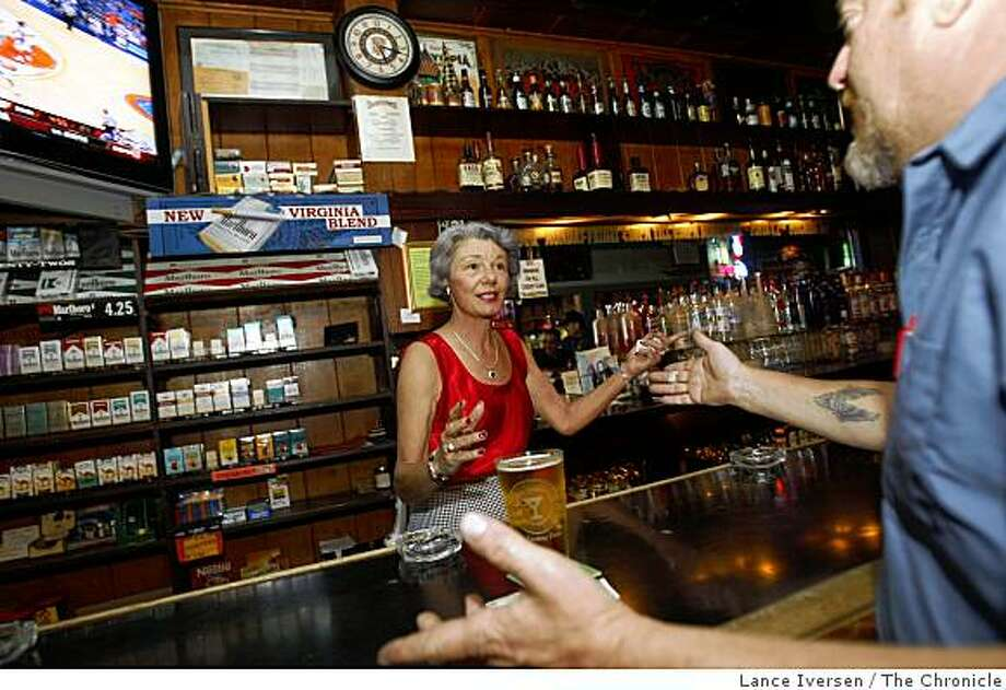 Beverly Swanson, president of Calif licensed Beverage Association, and a bar owner for the past two decades, serves her customers at the family owned tavern One Double Oh Seven Club & Smoking Parlor in Santa Cruz. She talks with Larry Goody a customer for the past 20 years regarding the proposed changes in the tax laws on Friday afternoon November 14, 2008. Photo: Lance Iversen, The Chronicle