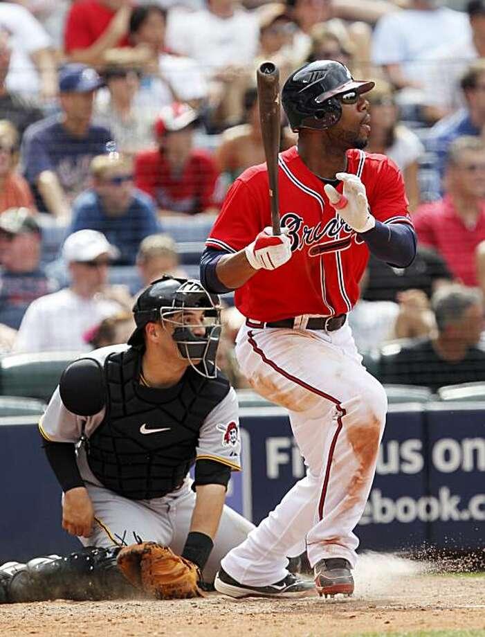 Atlanta Braves' Jason Heyward drives in two runs with a triple as Pittsburgh Pirates catcher Jason Jaramillo looks on in the eighth inning of a baseball game in Atlanta Sunday, May 30, 2010. Atlanta won 5-2. Photo: John Bazemore, AP