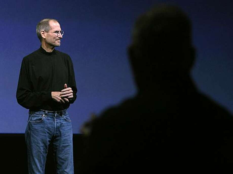 Apple CEO Steve Jobs received a standing ovation when he walked on the stage to introduce the iPad tablet to invited guests at the Yerba Buena Center for the Arts. Photo: Paul Chinn, The Chronicle