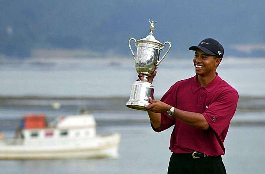 ** ADVNACE FOR WEEKEND EDITIONS, JUNE 12-13 - FILE - ** This June 18, 2000, file photo shows Tiger Woods showing off the winner's trophy after capturing the 100th U.S. Open Golf Championship at the Pebble Beach Golf Links in Pebble Beach, Calif. No one had ever been more dominant in 140 years of major championships. Most doubt they will see such a performance again. Photo: Elise Amendola, AP 2000