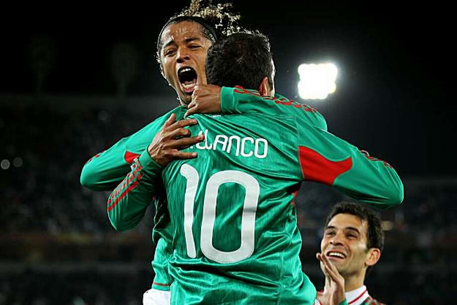 POLOKWANE, SOUTH AFRICA - JUNE 17:  Giovani Dos Santos of Mexico celebrates with Cuauhtemoc Blanco after he scored a penalty for his team's second goal during the 2010 FIFA World Cup South Africa Group A match between France and Mexico at the Peter MokabaStadium on June 17, 2010 in Polokwane, South Africa. Photo: David Cannon, Getty Images