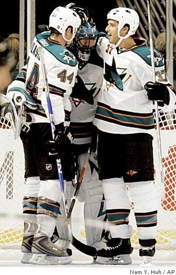 San Jose Sharks goalie Brian Boucher, center, celebrates with Marc-Edouard Vlasic, left, and Brad Lukowich after they defeated the Chicago Blackhawks 6-5 Sunday, Nov. 16, 2008, in Chicago. Photo: Nam Y. Huh, AP