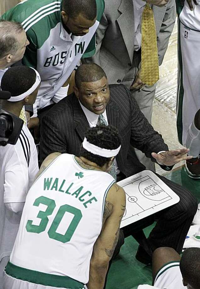 Boston Celtics coach Doc Rivers, center, coaches his team, including Rasheed Wallace (30), during a second-quarter timeout during Game 4 of the NBA basketball finals against the Los Angeles Lakers on Thursday, June 10, 2010, in Boston. Photo: Charles Krupa, AP