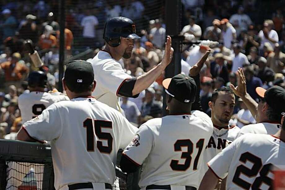 Aubrey Huff celebrates with teammates after his home run in the bottom of the sixth inning at AT&T Park on Sunday. Photo: Lea Suzuki, The Chronicle