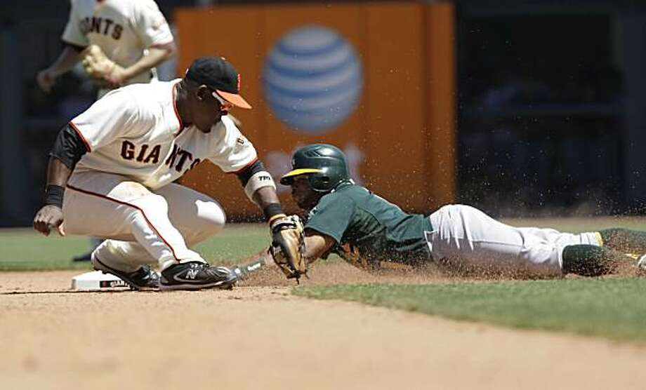 The Athletics' Rajai Davis steals second while the Giants' Juan Uribe tries to tag him out in the top of the seventh inning at AT&T Park on Sunday. Photo: Lea Suzuki, The Chronicle