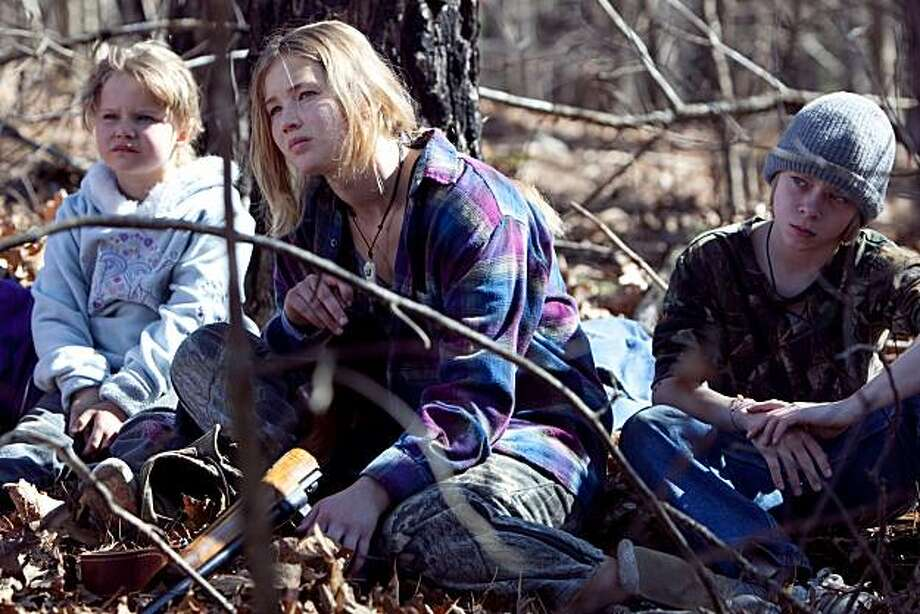 "In this film publicity image released by Roadside Attractions, from left, Ashlee Thompson, Jennifer Lawrence and Isaiah Stone are shown in a scene from, ""Winter's Bone."" Photo: Sebastian Mlynarski, AP"