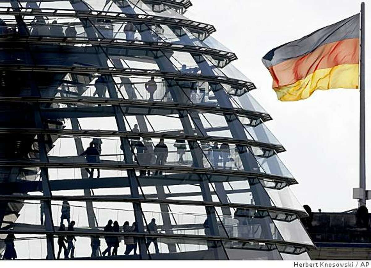 ** FILE ** In this March 20, 2008 file photo, tourists climb the dome of the Reichstag in Berlin, Germany. The glass dome atop the Parliament building offers dazzling views of the city, for free, and an opportunity to gawk at Germany's law makers below. (AP Photo/Herbert Knosowski, File)