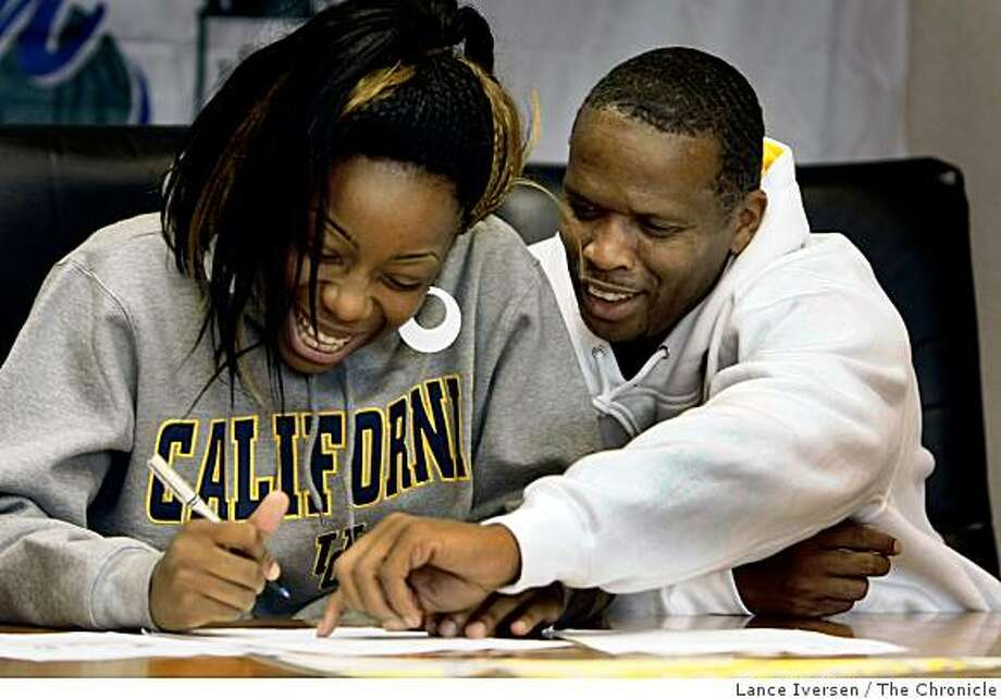 Tierra Rogers announced Wednesday she will play basketball for University of California at Berkeley next year. Rogers a Sacred Heart Cathedral player gets a little help from her God Father Guy Hudson as she signed a letter of intent during a ceremony that honored five Sacred Heart Cathedral athletes Wednesday November 12, 2008 Photo: Lance Iversen, The Chronicle