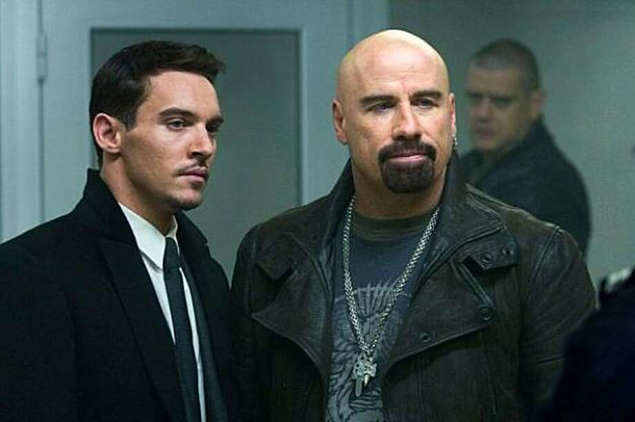 """Jonathan Rhys Meyers and John Travolta in """"From Paris With Love."""" Photo: Lionsgate"""