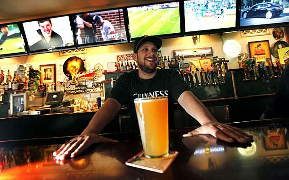The Englander bartender Craig Hewitt chats with customers after pours a beer for Kevin Dahm who was watching several of the restaurants 30 TV's. The Englander is known as a good sports pub venue, in San Leandro Ca and plans on showing lots of World Cup matches including the United States Vs, England June 12th. Saturday June 5, 2010. Photo: Lance Iversen, The Chronicle