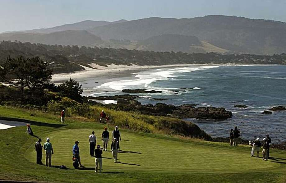 Golfers and their coaches, cadies and sponsors converge on the 8th green at Pebble Beach Golf Links Wednesday June 16, 2010 to takes measurements and practice putting. The 8th, 9th and 10th holes are considered by most to be the most difficult at Pebble Beach, site of the 110th annual US Open that gets underway Thursday morning at 7am. Almost anyone in the top half of the field can win this tournament, but these holes can take that win away. Photo: Lance Iversen, The Chronicle