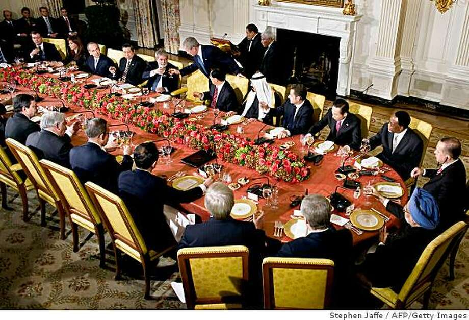 US President George W. Bush (C) toasts Brazil's President Luiz Inacio Lula da Silva along with the leaders of the G-20 countries during an official dinner at the White House in Washington November 14, 2008. The leaders of the G-20 leaders which represent 90 percent of the world's gross domestic product, will be meeting on November 15 to discuss the global financial crisis.              AFP PHOTO / International Monetary Fund /  Stephen Jaffe    == RESTRICTED TO EDITORIAL USE ONLY / NO SALES / GETTY OUT == (Photo credit should read STEPHEN JAFFE/AFP/Getty Images) Photo: Stephen Jaffe, AFP/Getty Images