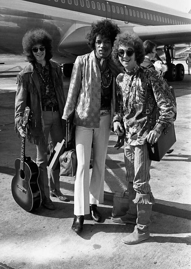 ** FILE ** This Aug. 21, 1967 file photo shows Noel Redding, left, Jimi Hendrix, center, and Mitch Mitchell, of the Jimi Hendrix Experience,  at Heathrow airport in London. Authorities say Mitch Mitchell, drummer for the legendary Jimi Hendrix Experience of the 1960s, has been found dead in his Portland, Ore. hotel room.  (AP Photo/Peter Kemp, file) Photo: Peter Kemp, File, AP