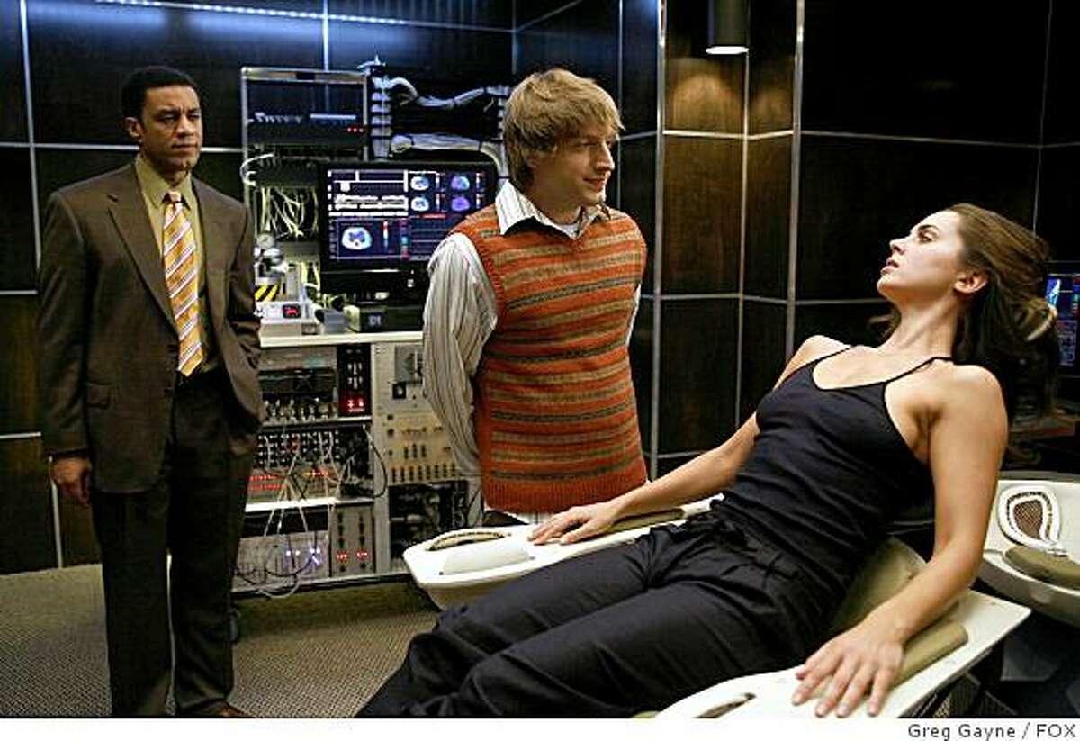 DOLLHOUSE: Boyd (Harry Lennix, L) and Topher (Fran Kranz, C) prepare Echo (Eliza Dushku, R) for her next engagement in DOLLHOUSE premiering Friday, Feb. 13 (9:00-10:00 PM ET/PT) on FOX.