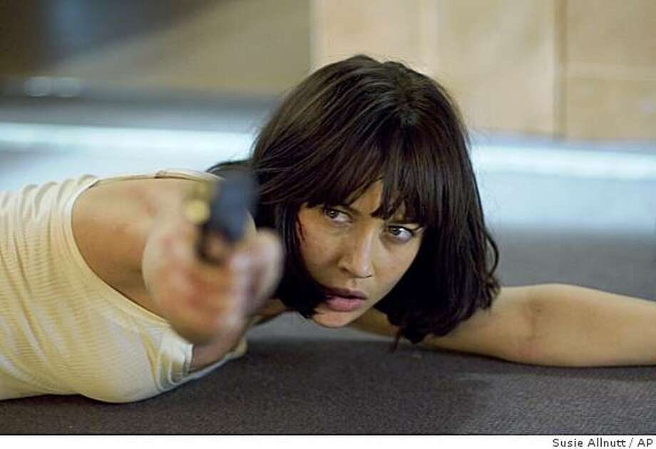 "In this image released by Sony Pictures, Olga Kurylenko  is shown in a scene from ""Quantum of Solace."" Photo: Susie Allnutt, AP"