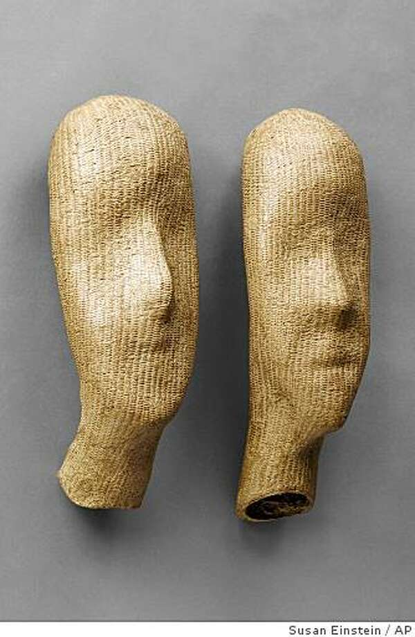"In this image released by the Japan Society, bamboo pieces by Nagakura Ken'ichi, (b. 1952) Left: Face I, 2007, and Right: Face II, 2007  are shown. The Japan Society has mounted an exhibition relating the story of the evolution of bamboo art from vessel to sculpture. ""New Bamboo: Contemporary Japanese Masters,"" is on display at The Japan Society in New York until Jan. 11.   (AP Photo/Japan Society, Susan Einstein) ** NO SALES ** Photo: Susan Einstein, AP"