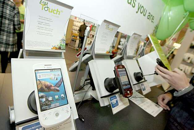 Cell phone retailers, under the ordinance, would be required to post the level of radio frequency absorbed into the body when using each device. Photo: Casey Rodgers, AP