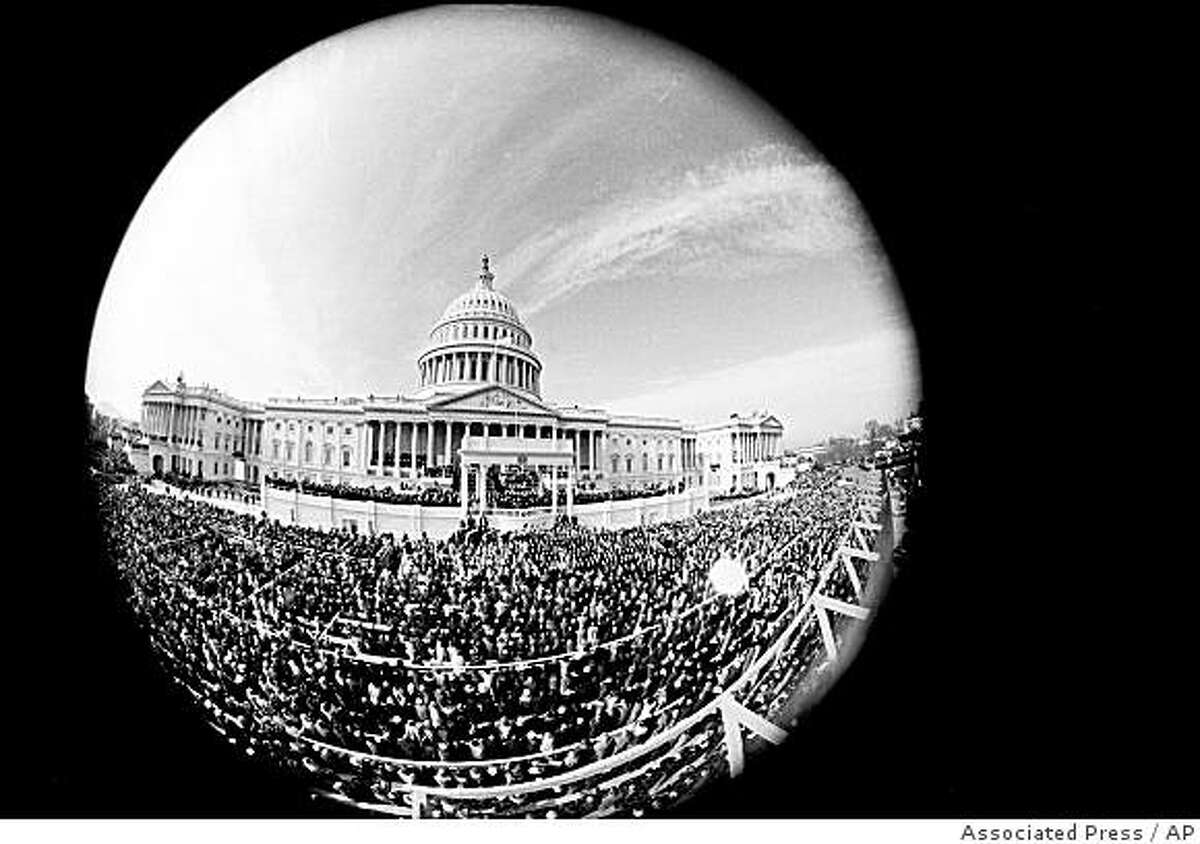 ** FILE ** In this Jan. 20, 1965 black-and-white file photo, this fisheye view shows the inauguration day ceremony of President Lyndon B. Johnson as he is sworn in as the 36th president of the United States. President-elect Barack Obama's inauguration is expected to draw 1 million-plus to the capital, and already some lawmakers have stopped taking ticket requests and hotels have booked up. (AP Photo, File)