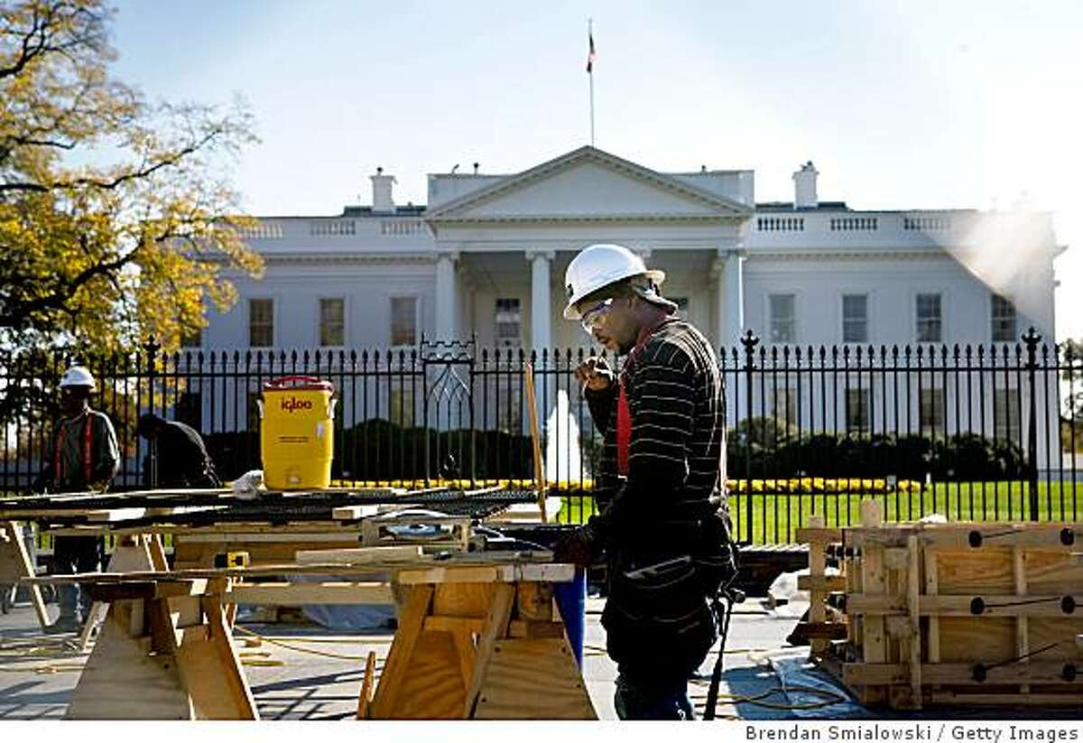 WASHINGTON, DC - NOVEMBER 7: Workers construct viewing stands in front of the White House for the Inaugural Parade on November 7, 2008 in Washington, DC. President-elect Barack Obama will be sworn in as the 44th President of the United States on January 20, 2009 in Washington DC. (Photo by Brendan Smialowski/Getty Images)