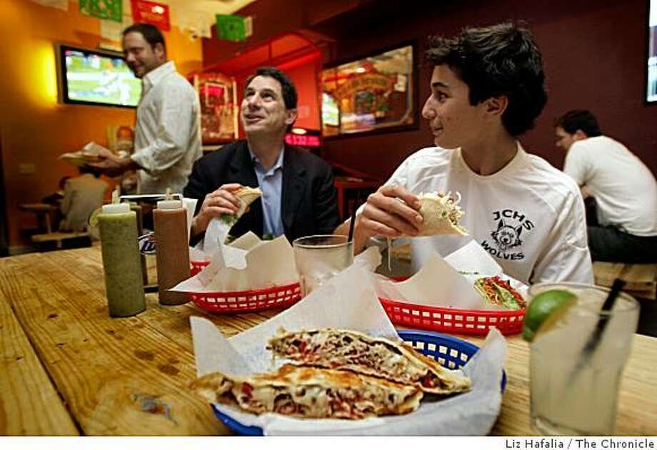 Merle Malakoff (left) and his son Max Malakoff, 14, having a fish taco and chicken taco, while a quesadilla and margarita are in front at Underdogs Sports Bar & Grill in San Francisco, CA.,  on Thursday, November 6, 2008. Photo: Liz Hafalia, The Chronicle