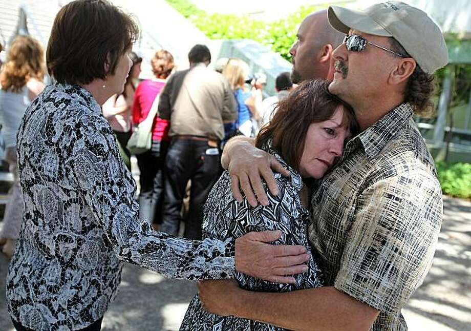 Robin Vargas, center, mother of Aaron Vargas, is consoled by her husband Robert Vargas, right, and her sister Linda Hruby following the sentencing of her son, Aaron Vargas, at the Mendocino County Courthouse, in Ukiah, Calif., on Tuesday, June 15, 2010.Aaron Vargas, 32, fatally shot a family friend accused of molesting him was sentenced to nine years in prison in the vigilante shooting. Photo: Christopher Chung, AP