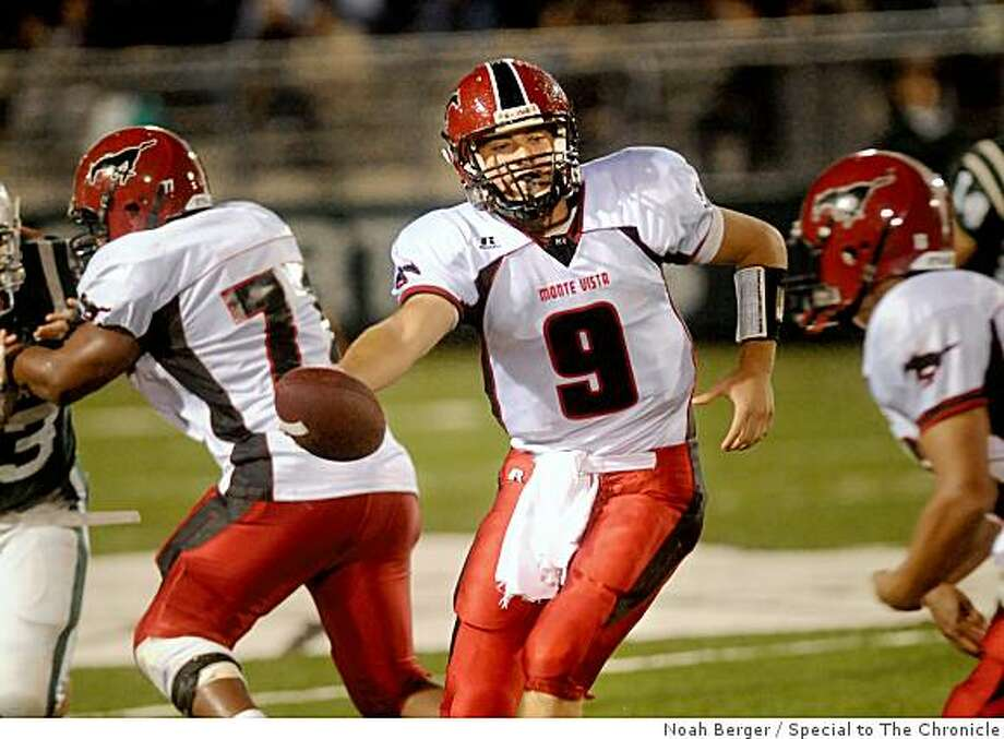 Monte Vista quarterback Brett Nottingham makes a hand off during the first quarter of a game against De La Salle on Friday, Oct. 31, 2008, in Concord, Calif. Photo: Noah Berger, Special To The Chronicle