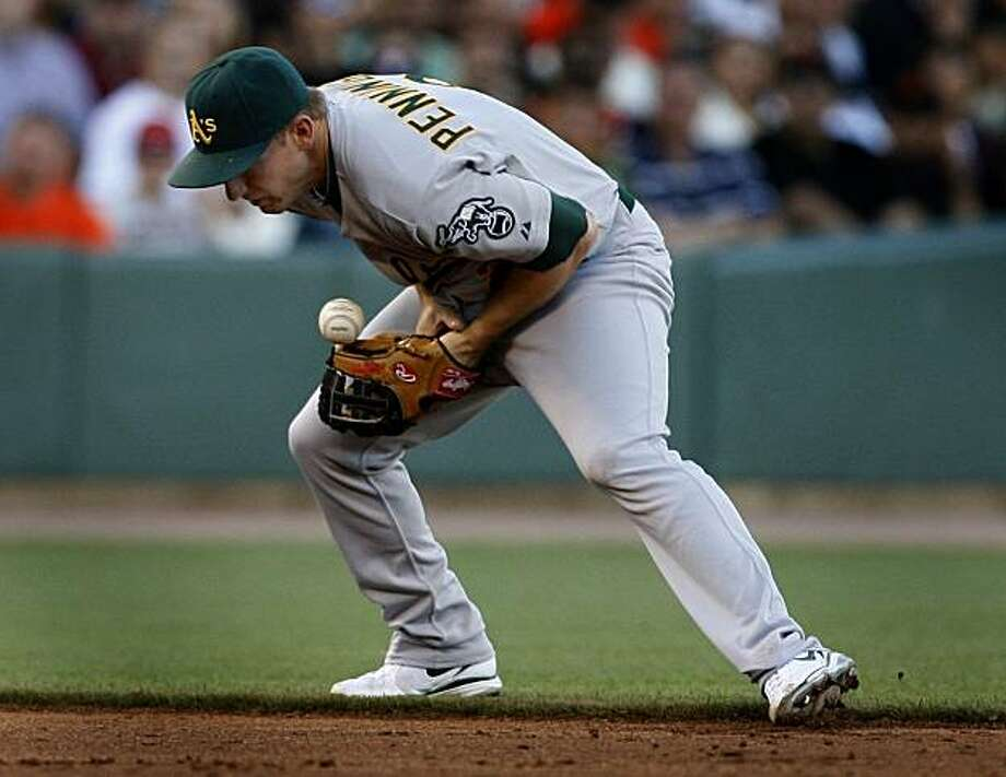 Oakland A's shortstop Cliff Pennington was charged with an error after he bobbled a grounder from Freddy Sanchez in the third inning at AT&T Park on Saturday. Photo: Paul Chinn, The Chronicle
