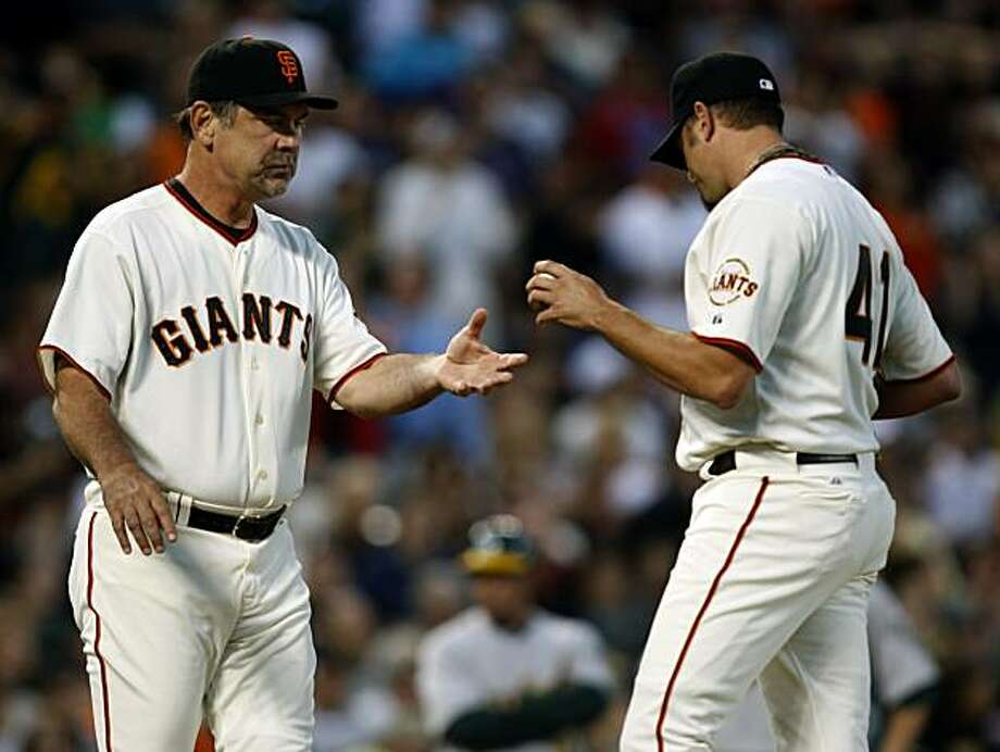 Manager Bruce Bochy takes the ball from reliever Jeremy Affeldt after the San Francisco Giants gave up two runs in the eighth inning at AT&T Park on Saturday. Photo: Paul Chinn, The Chronicle