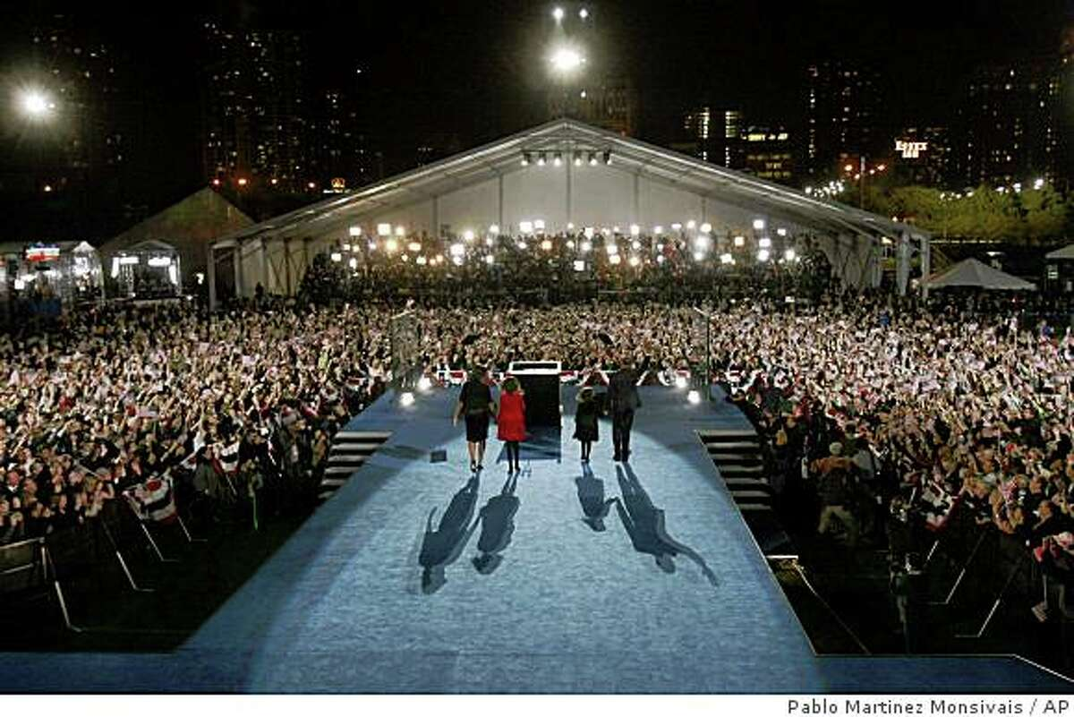 Democratic presidential candidate Sen. Barack Obama, D-Ill., his wife Michelle and daughters Malia, 10, and Sasha, 7, take the stage to deliver his victory speech at his election night party in Grant Park in Chicago, Tuesday night, Nov. 4, 2008.