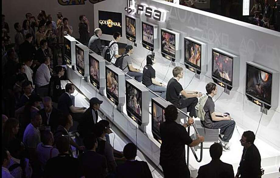 FILE - In this June 3, 2009 file photo, show attendees play the video game God of War III at the E3 Expo in Los Angeles. (AP Photo/Jae C. Hong, file) Photo: Jae C. Hong, AP