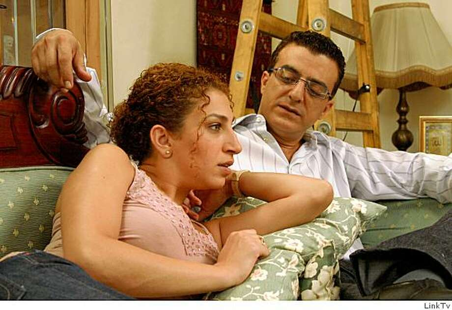 Norman Isa stars as Amjad in Arab Labor and is seen here in a scene with Clara Khoury as his wife Bushra in the Israeli sitcom now on LInks TV . Photo: LinkTv