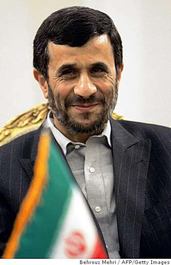 (FILES) -- File picture dated December 17, 2007 shows Iranian President Mahmoud Ahmadinejad before his departure to perform the annual Muslim pilgrimage in Saudi Arabia, at Tehran's Mehrabad airport. Ahmadinejad congratulated on November 6, 2008 US president-elect Barack Obama on his election -- rare praise between the two cuntries which are archfoes, state agency IRNA reported. AFP PHOTO/BEHROUZ MEHRI (Photo credit should read BEHROUZ MEHRI/AFP/Getty Images) Photo: Behrouz Mehri, AFP/Getty Images