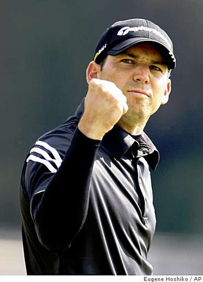 Sergio Garcia gestures on the 18th green after winning the 2008 HSBC Champions Monday, Nov. 10, 2008 in Shanghai. Photo: Eugene Hoshiko, AP