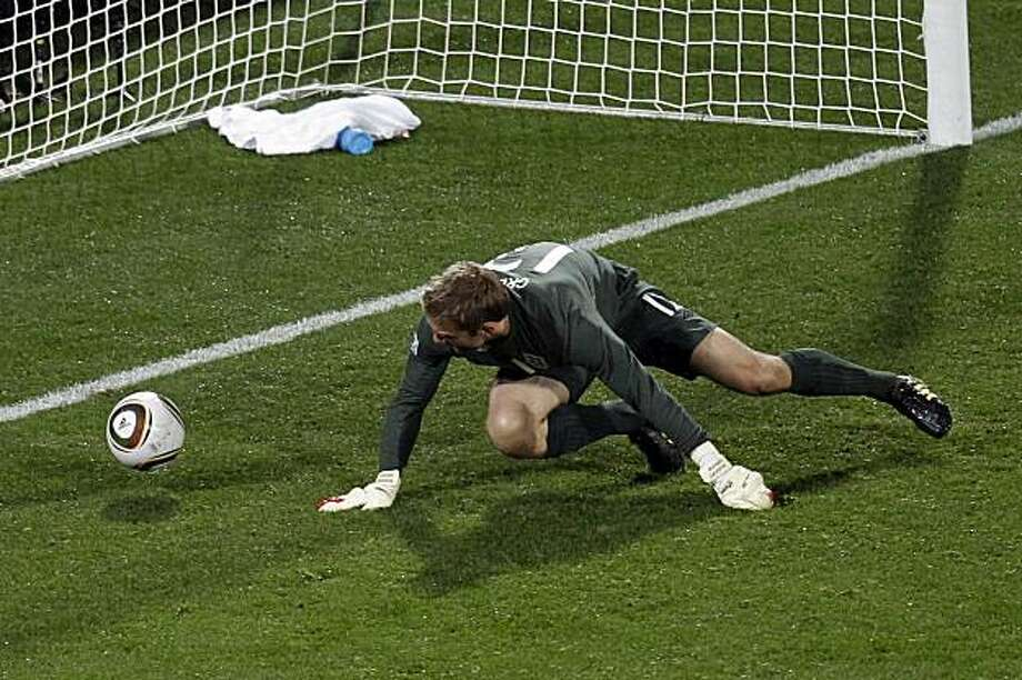 England's Robert Green fails to save a shot by United States' Clint Dempsey, not seen, during the World Cup group C soccer match between England and the United States at Royal Bafokeng Stadium in Rustenburg, South Africa, Saturday, June 12, 2010. Photo: Michael Sohn, AP