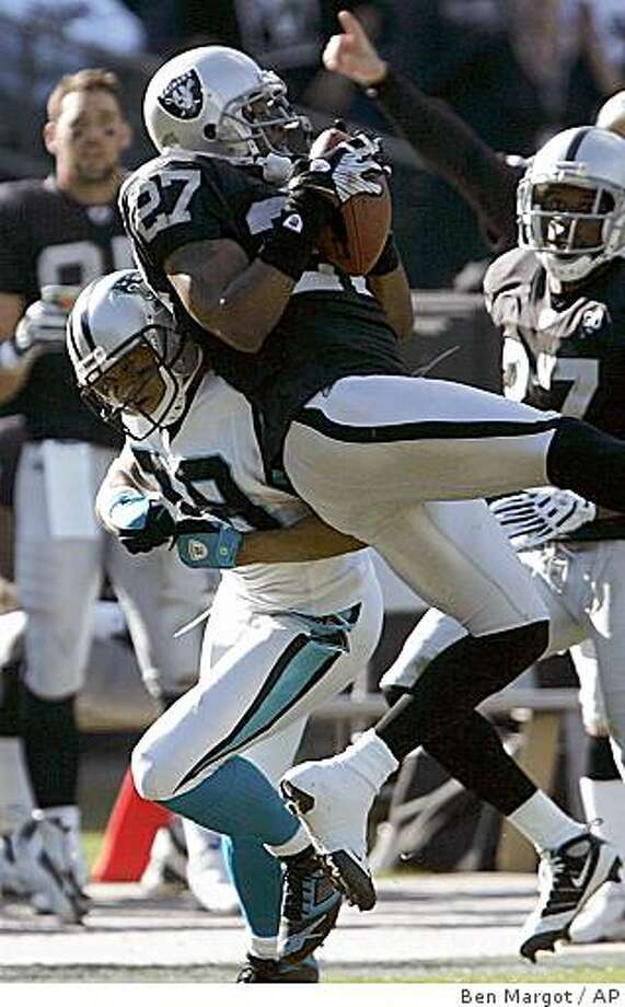 Oakland Raiders safety Rashad Baker (27) intercepts a pass intended for Carolina Panthers wide receiver Steve Smith, left, during the second quarter an NFL football game Sunday, Nov. 9, 2008, in Oakland, Calif. (AP Photo/Ben Margot) Photo: Ben Margot, AP