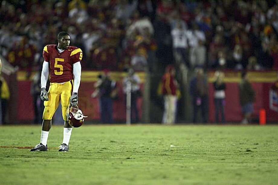 LOS ANGELES, CA - NOVEMBER 19:  Reggie Bush #5 of the USC Trojans stands on the field during the game with the Fresno State Bulldogs at the Los Angeles Memorial Coliseum on November 19, 2005 in Los Angeles, California. The Trojans won 50-42. (Photo by Jeff Gross/Getty Images) Photo: Jeff Gross, Getty Images 2005