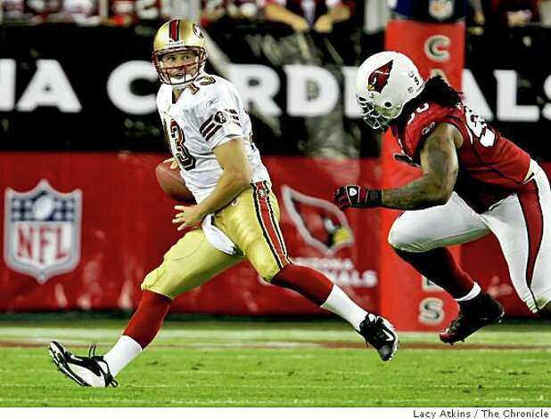 San Francisco 49ers  Shaun Hill is presured by  Arizona Cardinals defensive tackel Darnell Dockett, in the fourth quarter,  Monday Nov. 10, 2008, in Phoenix, Az. Photo: Lacy Atkins, The Chronicle