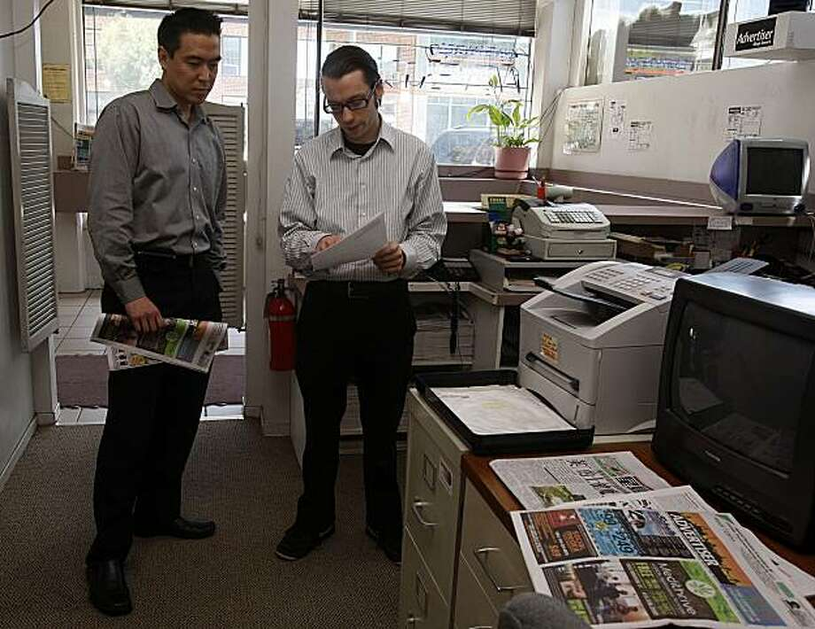 Co-owner Brad Wing (left), and inside sales associate Sean Hussey (right) of the San Francisco Advertiser discuss ad sales in San Francisco, Calif., on Thursday, June 3, 2010.  Brad Wing received a 58.3 percent increase notice from medical insurance companies back in April. Photo: Liz Hafalia, The Chronicle