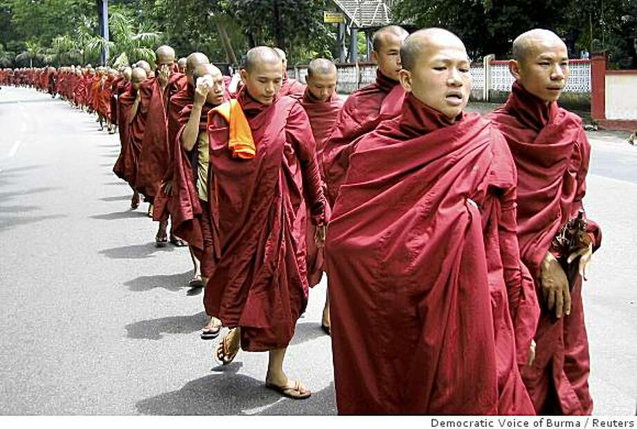 Buddhist monks march through the streets of Yangon September 18, 2007. Buddhist monks staged protest marches in at least two cities, including Yangon and Sittwe, in Myanmar on Tuesday, the day a reported religious boycott of members of the ruling military junta and their associates was due to start. REUTERS/Democratic Voice of Burma (MYANMAR) Photo: Democratic Voice Of Burma, Reuters