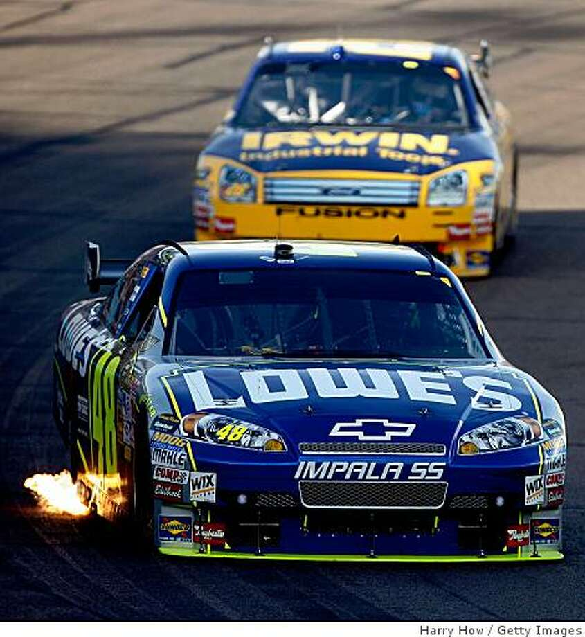 Jimmie Johnson leads Jamie McMurray during the NASCAR Sprint Cup Series Checker O'Reilly Auto Parts 500 at Phoenix International Raceway on November 9, 2008 in Avondale, Arizona. Photo: Harry How, Getty Images