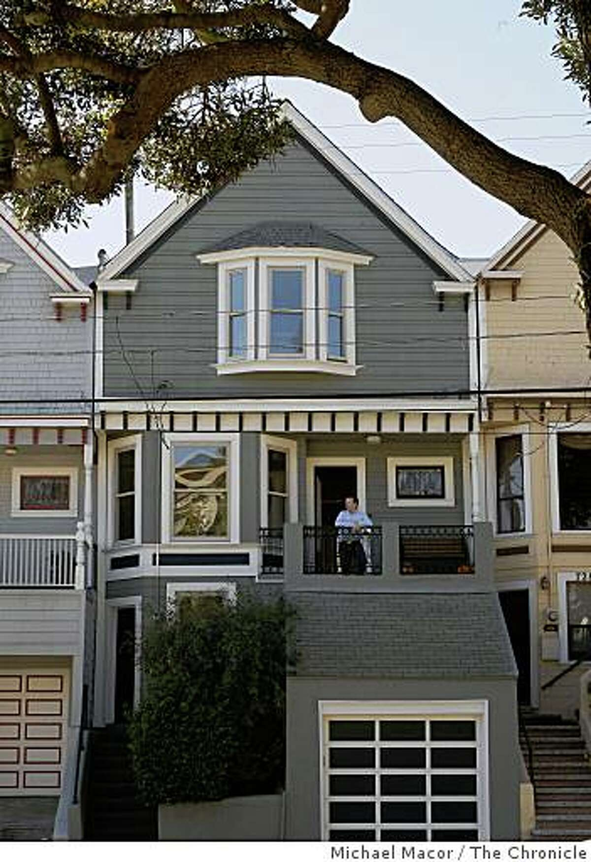 Adam Woollerson, on the porch of his the Noe Valley home, on Friday Nov. 7, 2008, in San Francsico, Calif., which is among only a handful of areas in the Bay Area that has seen an increase in in home values.