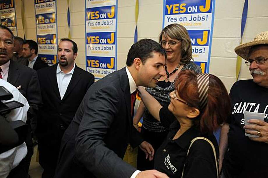 Jed York hugs Lidia Blair as elections results for Measure J come in at the American Legion Hall in Santa Clara on Tuesday. Photo: Carlos Avila Gonzalez, The Chronicle