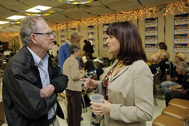 Santa Clara Mayor Patricia Mahan speaks with Measure J supporter Bob Tower at the American Legion Hall in Santa Clara as election results come in Tuesday. Photo: Carlos Avila Gonzalez, The Chronicle