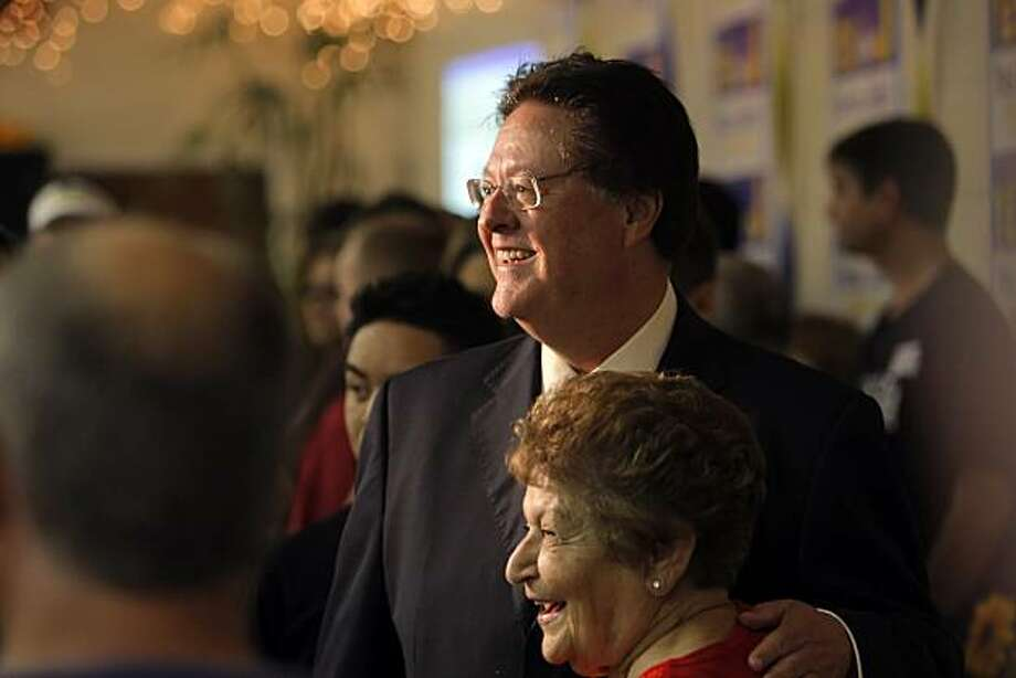 John York poses for a photo with Laura Mahan, mother of Santa Clara Mayor Patricia Mahan at a party celebrating the election results for Measure J at the American Legion Hall in Santa Clara on Tuesday. Photo: Carlos Avila Gonzalez, The Chronicle