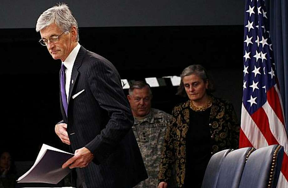 ARLINGTON, VA - JUNE 10:  U.S. Secretary of the Army John McHugh (L), U.S. Army Inspector General Lt. Gen. Steven Whitcomb (C) and Kathryn Condon (R), special assistant to the Undersecretary of the Army, arrive for a briefing at the Pentagon on the disclosure that the remains of 211 U.S. service members had been misidentified or improperly recorded at Arlington National Cemetery on June 10, 2010 in Arlington, Virginia. The information was released following a report by the U.S. Army Inspector General thatresulted in the cemetery's two civilian leaders being removed from their positions. Photo: Win McNamee, Getty Images