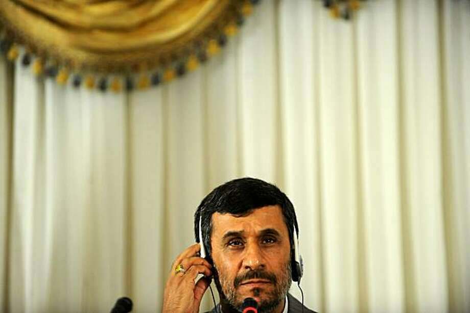 Iranian President Mahmoud Ahmadinejad salutes after a press conference in Istanbul June 8, 2010 at the summit of the Conference on Interaction and Confidence Building Measures in Asia (CICA). The nuclear fuel swap deal reached between Iran and Turkey andBrazil is an opportunity that will not be repeated, Ahmadinejad said. Photo: Bulent Kilic, AFP/Getty Images