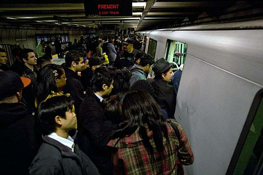 New Years revelers pack a Fremont-bound BART train at Embarcadero Station in downtown San Francisco, Calif. on Friday, Jan. 1, 2010, after the midnight fireworks show. Increased police and security presence at local BART stations led to a relatively calm New Years. Photo: Adam Lau, The Chronicle